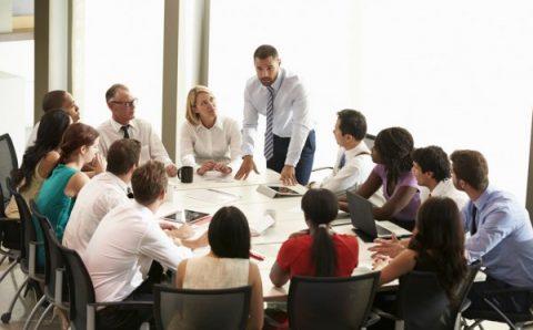 depositphotos_48459951-stock-photo-businessman-addressing-meeting-around-boardroom